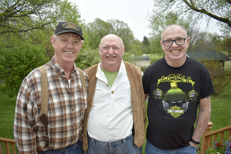 -Messenger photo by Chad Thompson<br /> <br /> Brothers Norm Edwards, a U.S. Army veteran of Otho, left, Phil Edwards, a U.S. Marine Corps veteran of Oak Hill, California, and Kevin Edwards, a U.S. Marine Corps veteran of Badger, are pictured during a family cookout Friday night at Norm's house in Otho.