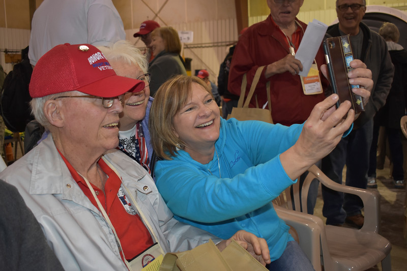 -Messenger photo by Chad Thompson<br /> <br /> Leonard Walde, a U.S. Army veteran of Westside, front, poses for a picture with his wife, Shirley Walde, center, and daughter, Wanda Conway, of Webster City, at the Fort Dodge Regional Airport Saturday morning.