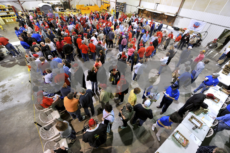 -Messenger photo by Hans Madsen<br /> <br /> Veterans, guardians and family members check in at the Fort Dodge Regional Airport for the Brushy Creek Area Honor Flight to Washington D.C. Saturday morning.