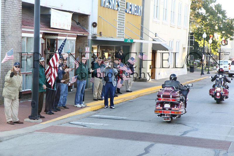 Brenham residents and business owners stand tall and proud to welcome the WWII veterans to their town.