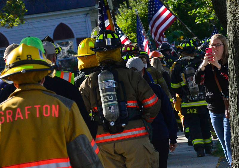 KRISTOPHER RADDER — BRATTLEBORO REFORMER<br /> People photograph as a couple of hundred local firefighters walked 3.43 miles in Bellows Falls, Vt., on Saturday, Sept. 12, 2020, to honor the 343 firefighters who died during the 9/11 terrorist attacks.
