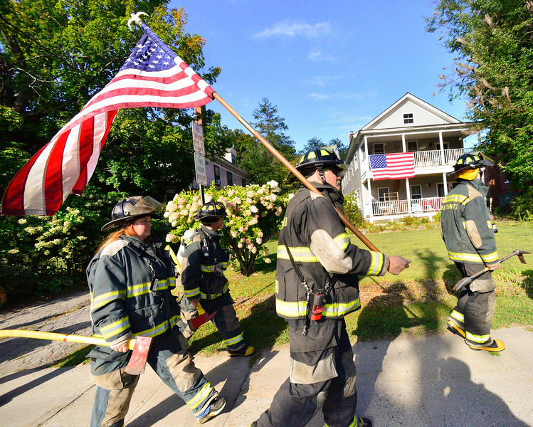 KRISTOPHER RADDER — BRATTLEBORO REFORMER<br /> Couple hundred local firefighters walked 3.43 miles in Bellows Falls, Vt., on Saturday, Sept. 12, 2020, to honor the 343 firefighters who died during the 9/11 terrorist attacks.