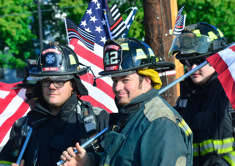 KRISTOPHER RADDER — BRATTLEBORO REFORMER<br /> Michael Stetson, of Westminster, Vt., Fire Department, joins other firefighters from the local area as they walked 3.43 miles in Bellows Falls, Vt., on Saturday, Sept. 12, 2020, to honor the 343 firefighters died during the 9/11 terrorist attacks.
