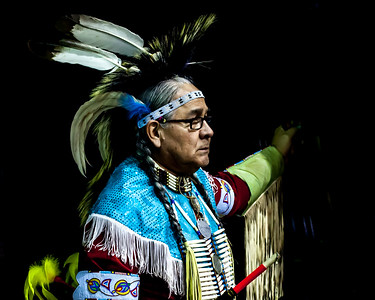 Photo was taken at the MSU American Indian Powwow.  It shows an elder taking a break from the ceremony and dancing.  Photo won First Place in the People category in the Big Sky Country Fair Photo Contest (Gallatin County) in 2019.