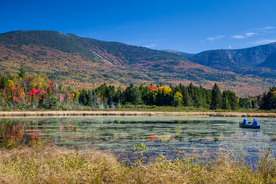 Fall colors light up Mt. OJI and the banks around Moose View Cove on Kidney Pond at Baxter State Park, Maine.  This shot appeared as the cover photo on the Baxter State Park 2016 Calendar.