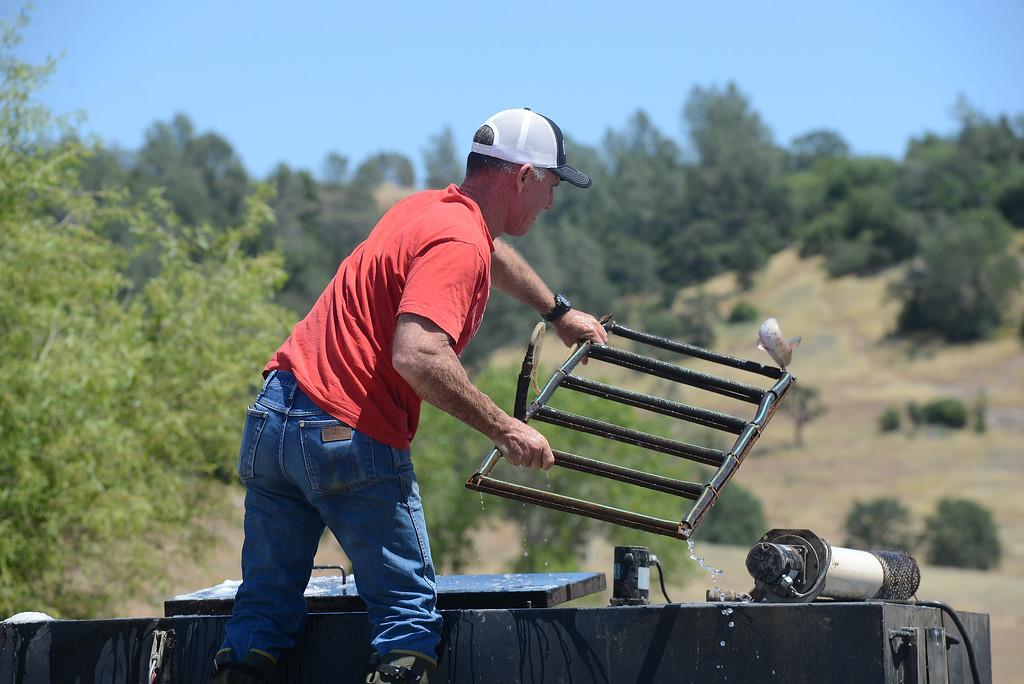 . Lance Bundy stocks Horseshoe Lake with catfish for Hooked on Fishing, May 1, 2018,  in Chico, California. (Carin Dorghalli -- Enterprise-Record)