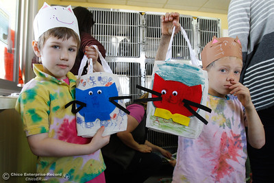 Jackson Rassmusen and Cody Dillard show their special cat book bags as they visit the Butte Humane Society's Cat Adoption Center to read to the cats March 22, 2016 in Chico, Calif. (Emily Bertolino -- Enterprise-Record)