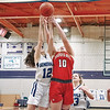 JUDITH GIBSON-OKUNIEFF — EAGLE CORRESPONDENT<br /> Hoosac Valley's Gabby Billetz and Pittsfield's Randi Duquette sky for a rebound on Thursday night at PHS.