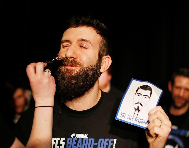 HOLLY PELCZYNSKI - BENNINGTON BANNER Hoosick Falls Central School art teacher Robert Viera smiles as he gets his beard shaved during the 4th annual beard off event.