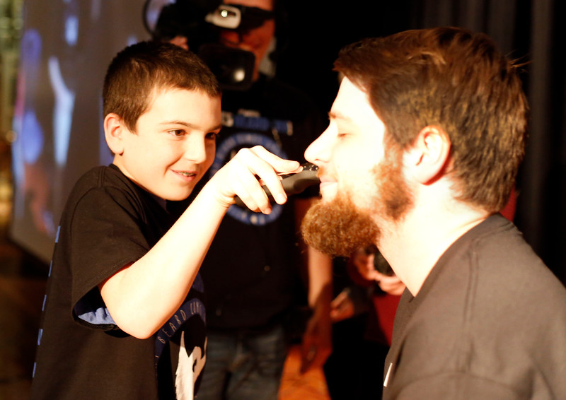 HOLLY PELCZYNSKI - BENNINGTON BANNER 7th Grader Brody Mullen stays focused while shaving the beard of science teacher James Lynch.