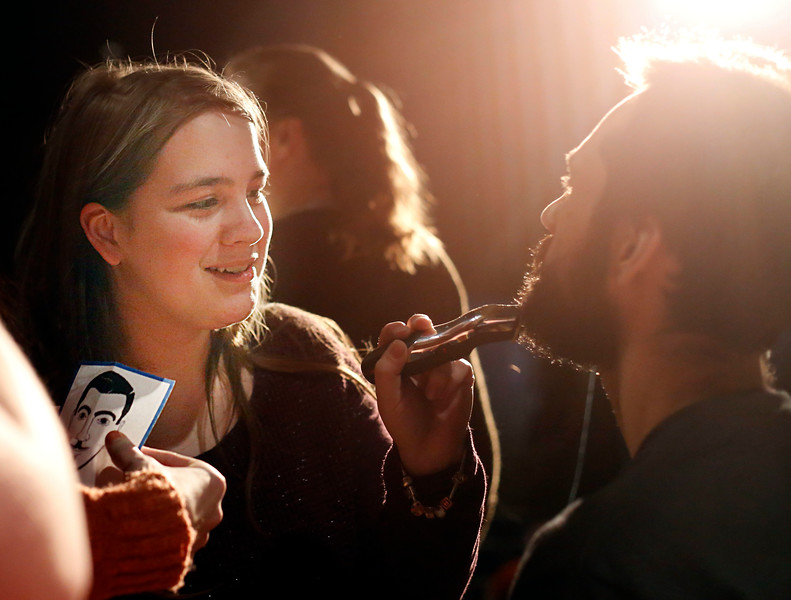 HOLLY PELCZYNSKI - BENNINGTON BANNER Hoosick Falls Central School junior Bridget Redick shaves the beard of her science teacher Mr. Calebrese during the 4th annual beard off event.