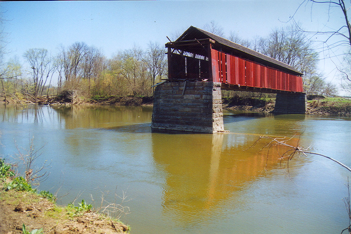 Bell's Ford Covered Bridge photo from April 1999, a few weeks following a windstorm which took out the western span of bridge.  About seven years later the other span was lost during a flood.