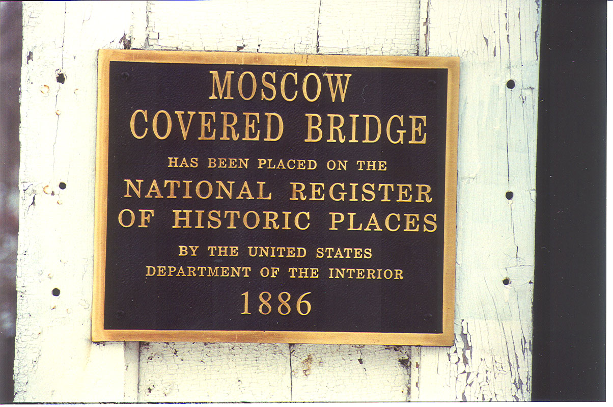 Plaque inside of the Moscow Covered Bridge, Rush County, Indiana. Photographed in 1991.<br /> <br /> updated: 6/4/2008 1:23:00 PM<br /> <br /> [UPDATED] Storm Devastates Rush County Community<br /> InsideINdianaBusiness.com Report<br /> <br />  Moscow resident Brian Colestock says his home was damaged by the powerful storm.<br /> <br /> Residents and business owners in several Indiana counties are assessing damage caused by powerful storms that roared through much of the state last night. Our partners at Network Indiana./WIBC report the town of Moscow in Rush County was nearly blown off the map. The state's longest covered bridge has been destroyed. It spanned the Flat Rock River.<br /> <br /> Source: Inside Indiana Business<br /> <br /> Update June 2010:  Great news...the Moscow Covered Bridge has been rebuilt!!
