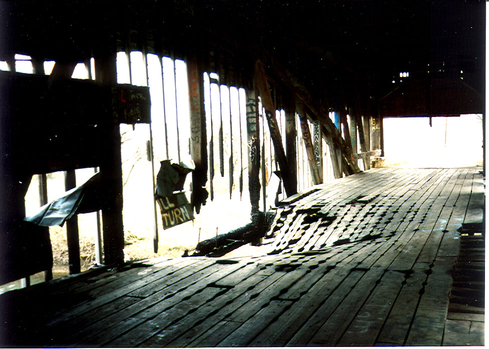Interior view of Smith Bridge, 1992.  Bridge had been partially burned and in very bad condition.
