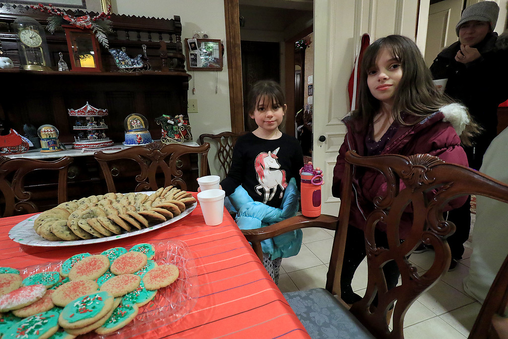 . Jack Hoover opened his home again this year for the annual Toys for Tots fundraiser he has put on for 11 years. Enjoying some cookies and drinks at the event is Violet Roland, 7, and Evelyn Roland, 9. SENTINEL & ENTERPRISE/JOHN LOVE