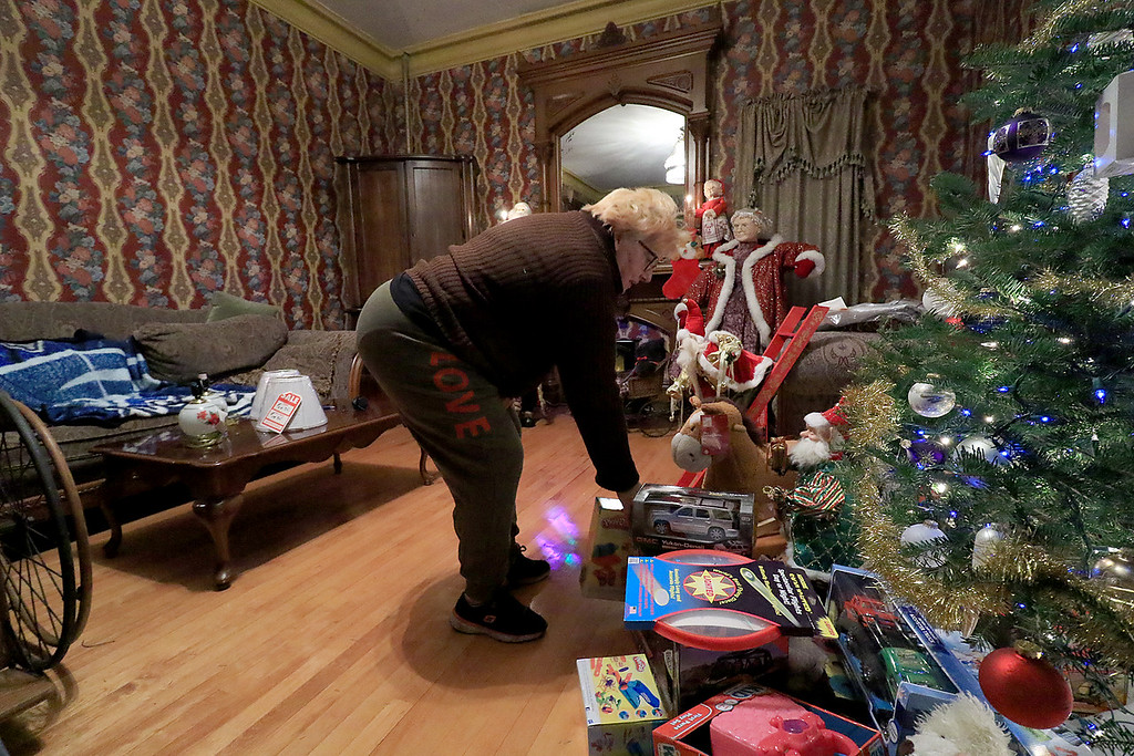 . Jack Hoover opened his home again this year for the annual Toys for Tots fundraiser he has put on for 11 years. Cindy Albert drops off a toy during the event. SENTINEL & ENTERPRISE/JOHN LOVE