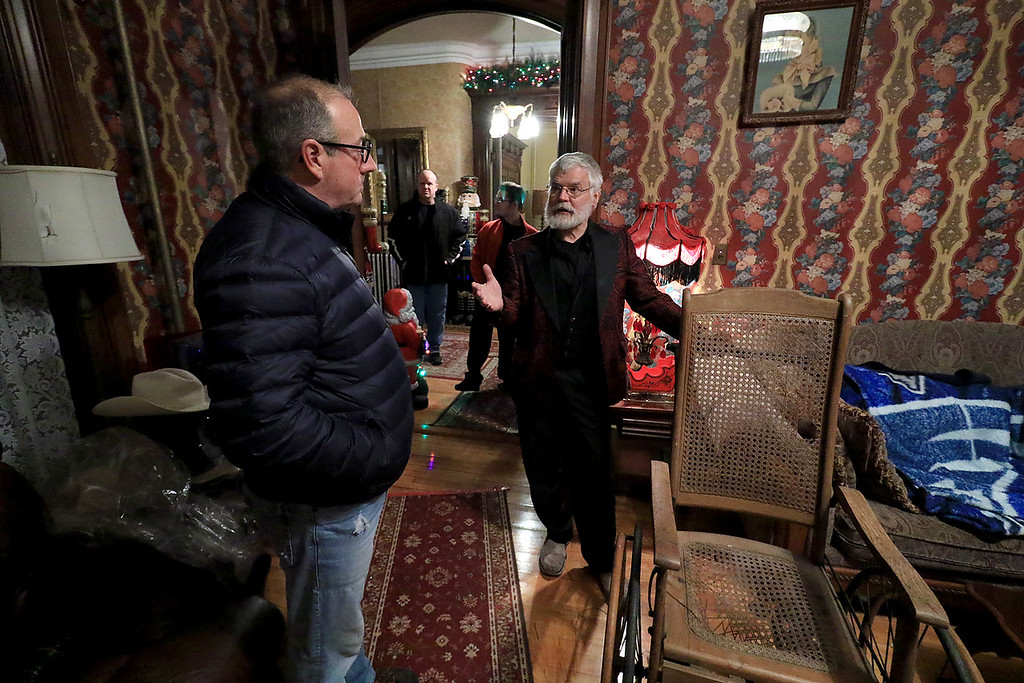 . Jack Hoover opened his home again this year for the annual Toys for Tots fundraiser he has put on for 11 years. Eddy Albert talks with Hoover during the event. SENTINEL & ENTERPRISE/JOHN LOVE