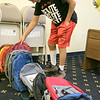 The Hope Center Project in Fitchburg on Harvard Street distributed back packs for school to area kids on Saturday, August, 25, 2019. Picking out a pack for himself is Brian Clapper, 14, of Fitchburg. SENTINEL & ENTERPRISE/JOHN LOVE