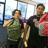The Hope Center Project in Fitchburg on Harvard Street distributed back packs for school to area kids on Saturday, August, 25, 2019. Showing off the packs they picked out is Gustavo Lagos, 11, and Carlos Lagos, 17. SENTINEL & ENTERPRISE/JOHN LOVE