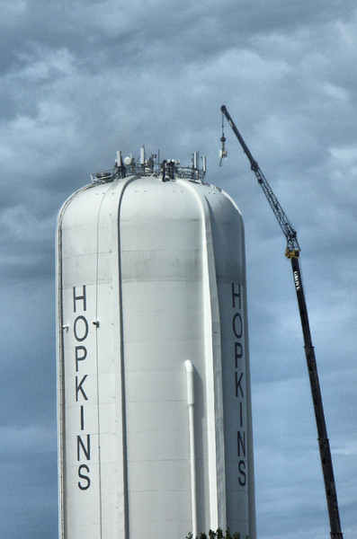 Hopkins water tower with crane