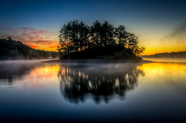 Sunrise Island Silhouette at Hopkinton State Park - Tom Sloan