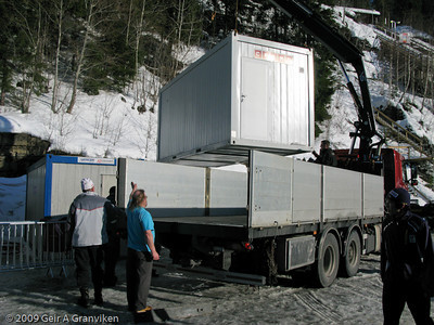 Another mobile ski preparation shack beeing lifted into place in the team area