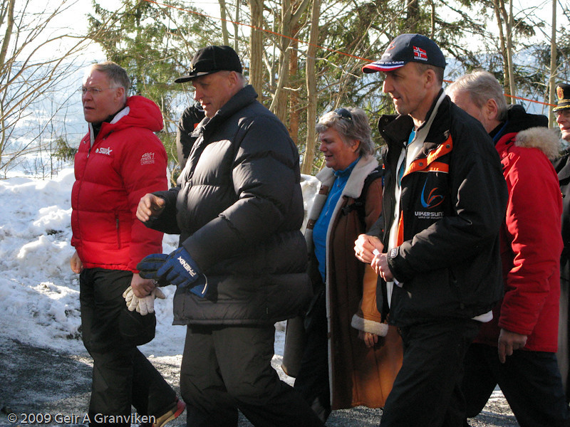 HM King Harald heading for the prize seremony, after having attended the flying hill jumping
