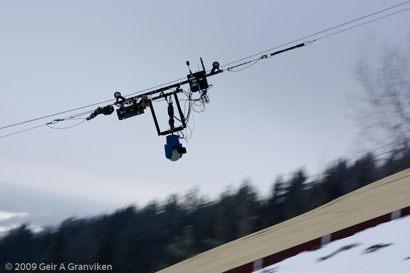 "NRK's remote TV camera, ""flying"" in formation with the jumpers, is able to travel up and down at impressive speeds"