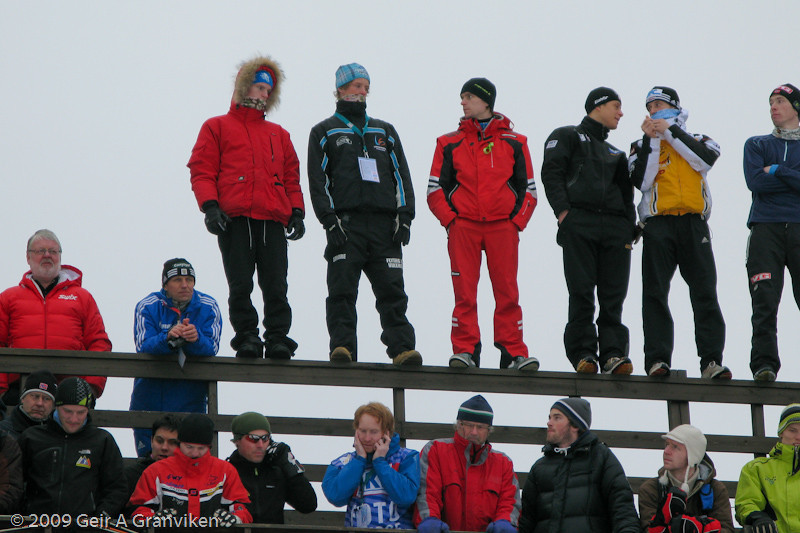 The two junior jumpers from Flying Team Vikersund at upper left wonders when they will be allowed to take off in the Flying Hill