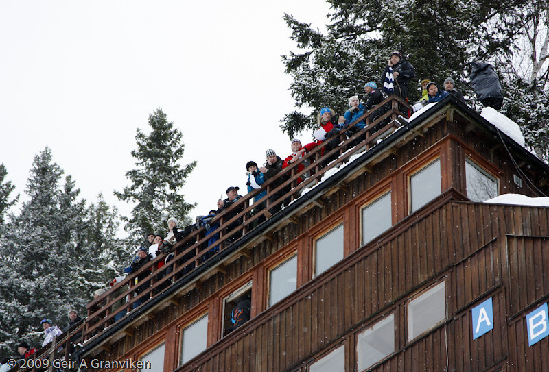 Spectators on the rooftoop on the judges' tower