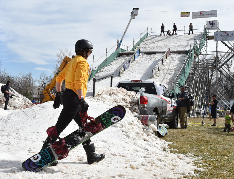 Emily Blewitt walks to go up the slope for another run at Hops and Rails at Roosevelt Park on Saturday.<br /> David R. Jennings/Staff Photographer<br /> March 12, 2016