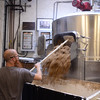 Spent grain being removed from the mash tun Threes Brewery
