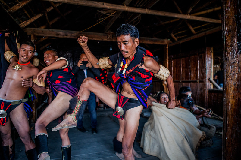 Members of the Chang tribe having some fun in their morung at the Hornbill Festival, Nagaland, India