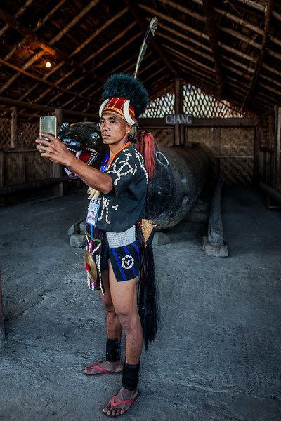 A youngster of the Phom tribe takes a selfie at the Hornbill festival in Nagaland, India
