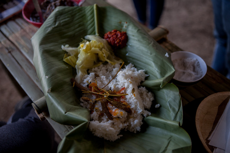 A meal of rice with Anishi Aon, slow cooked prok with colocasia patties, at the Ao morung during the Hornbill Festival, Nagaland, India