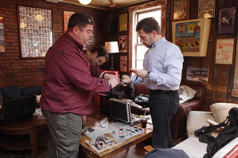 Stef and Wen handling some watches.