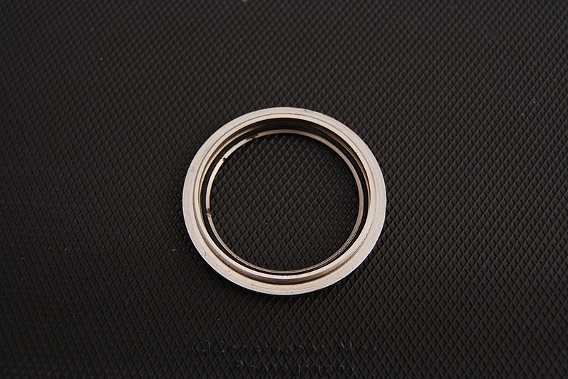 """Backside of crystal retainer ring. Gasket #3 to form the """"Triple Safe"""" seal."""