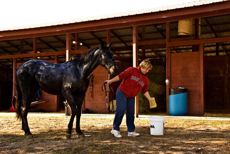 Tina bathes Seer of Patmos after training.