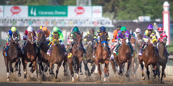 The field for the Kentucky Derby head down the stretch after the break from the gate on 5.3.2014 at Churchill Downs.
