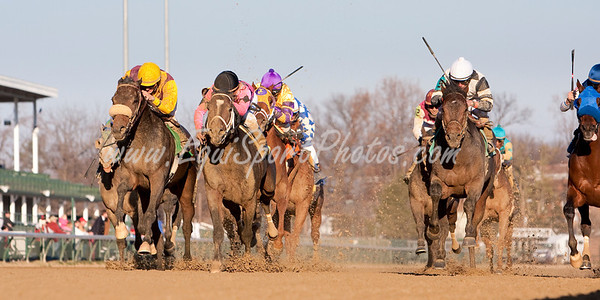 High Spirit (gold cap, Stephen Got Even), Terry Thompson up, wins an Allowance at Churchill Downs 11.27.2009mw
