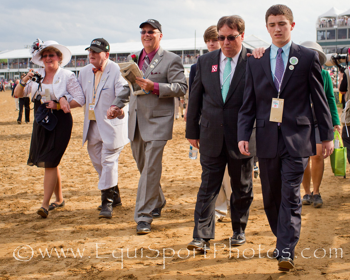 Kiaran McLaughlin, trainer for Soldat walks with his son for the Kentucky Derby at Churchill Downs on 05.07.2011