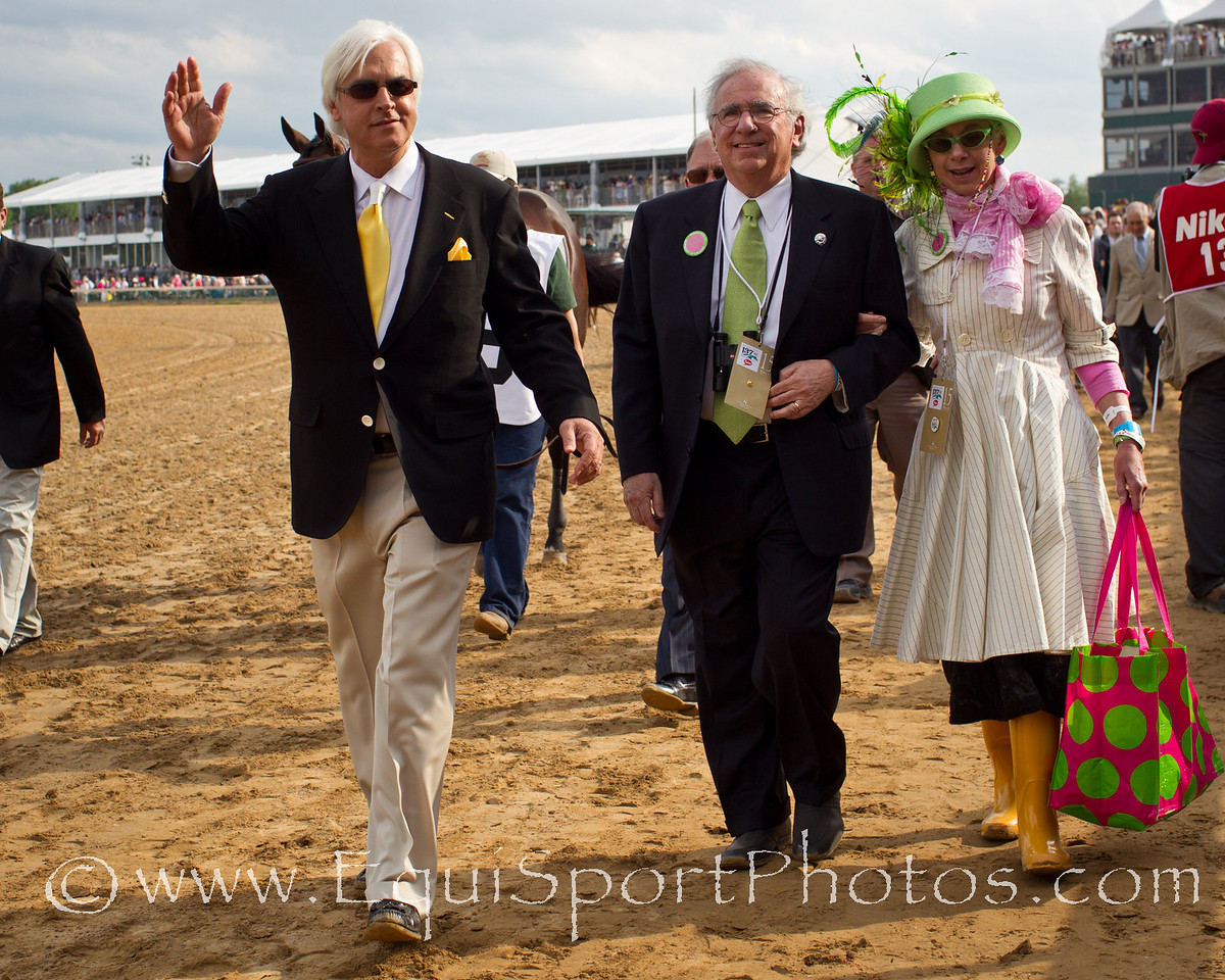Bob Baffert, trainer for Midnight Interlude waves to the crowd on his way to the Kentucky Derby at Churchill Downs on 05.07.2011