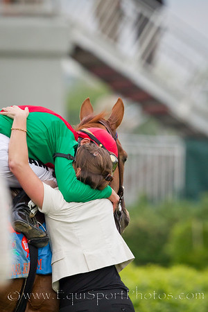 Johnny Valezquez, jockey and Heather Craig, assistant trainer, with Animal Kingdom in the winners circle of the Kentucky Derby.