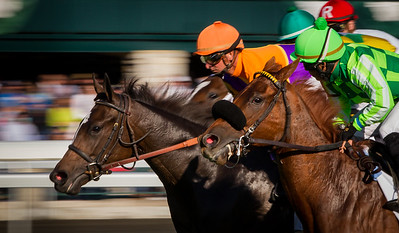 Moonwalk (orange cap, Malibu Moon), Corey Lanerie up, wins the JP Morgan Chase Jessamine Stakes at Keeneland 10.11.12. Trainer: Dale Romans, Owner: Spendthrift Farm.