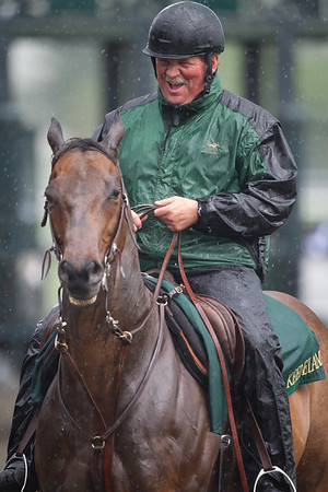 John, the lead outrider at Keeneland enjoying a good laugh in the pouring rain prior to the Lexington Stakes on 4.23.11