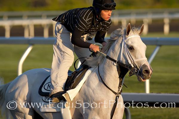 Hansen, with Joe Sharp, gallops at Keeneland 4.13.2012