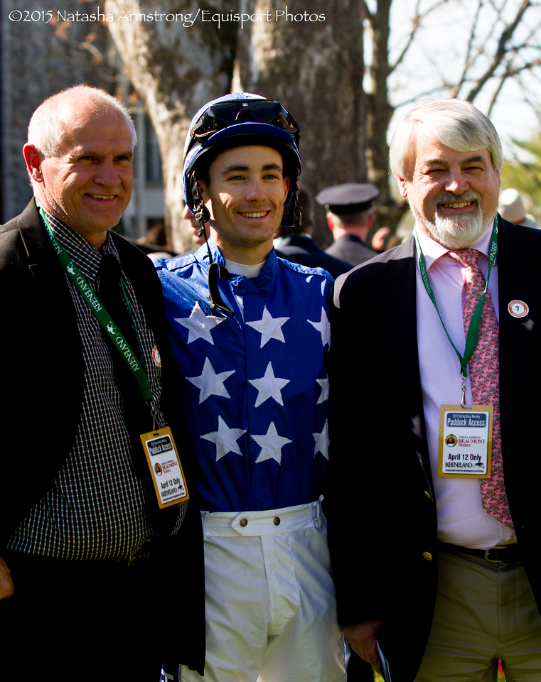 Jockey Channing Hill poses with the owner and trainer of his mount Belle Ete