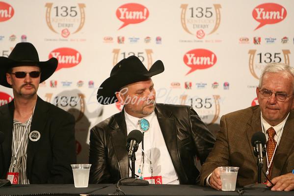 Chip Woolley (left) along side Mark Allen and Leonard Blach after winning the 2009 Kentucky Derby with Mine that Bird.