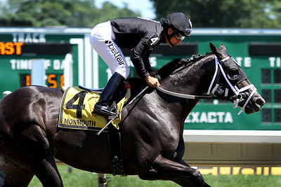 Sharp Azteca (Freud) and jockey Paco Lopez win the Monmouth Cup (Gr III) at Monmouth Park 7/30/17. Trainer: Jorge Navarro. Owner: Gelfenstein Farm