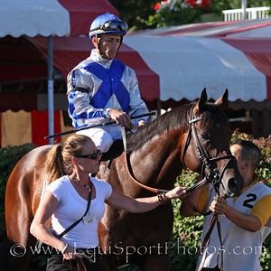 Blame and jockey Garrett Gomez go to post for the Whitney Stakes at Saratoga Racecourse 8/7/10 JH.